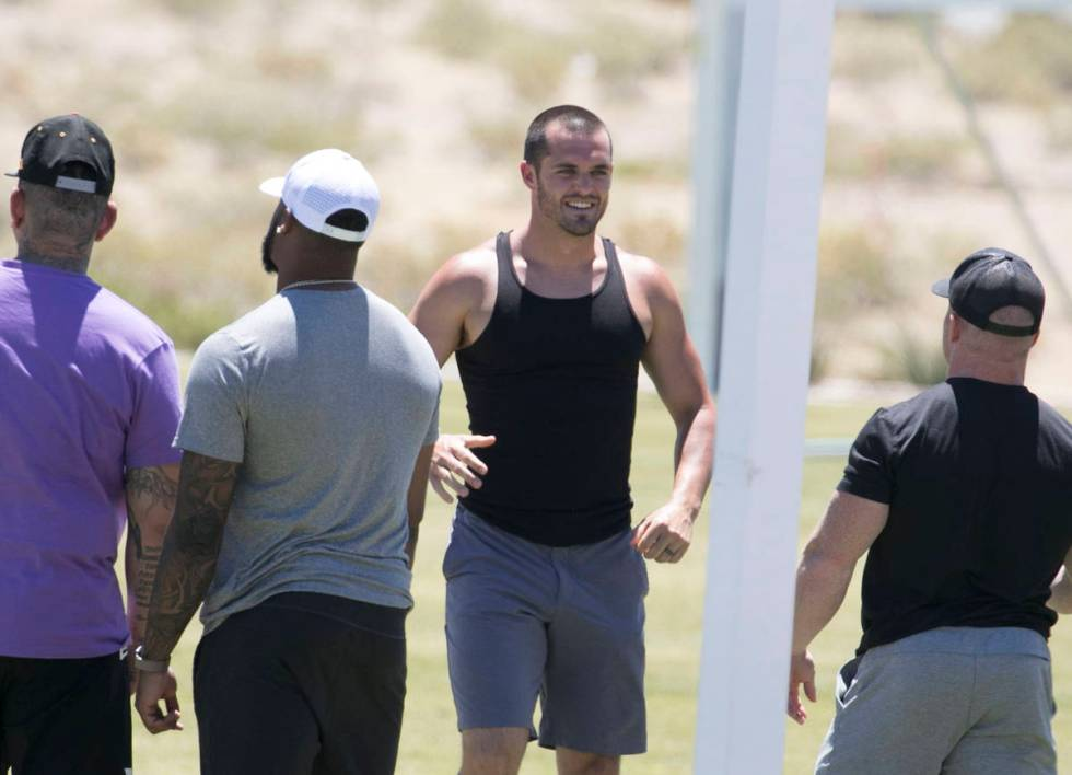 Las Vegas Raiders quarterback Derek Carr, second right, is seen after an unofficial practice on ...