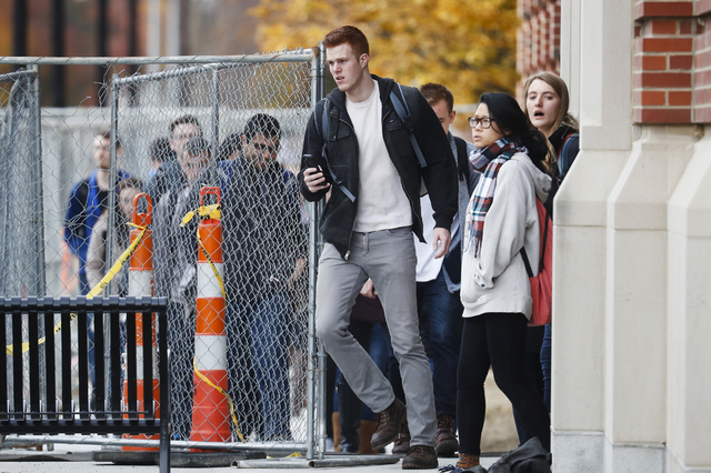 Students leave buildings as police respond to an attack on campus at Ohio State University, Monday, Nov. 28, 2016, in Columbus, Ohio. (John Minchillo/AP)