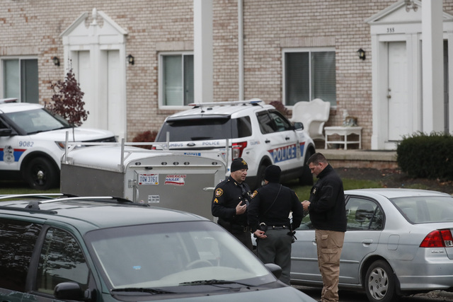 Police stand guard outside a residence of interest during their investigation into an earlier attack at The Ohio State University campus, Monday, Nov. 28, 2016, in Columbus, Ohio. (AP Photo/John M ...