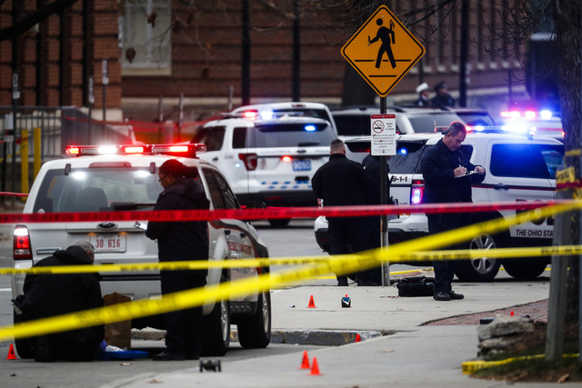 Crime scene investigators collect evidence from the pavement as police respond to an attack on campus at Ohio State University, in Columbus, Ohio, on Nov. 28, 2016. (John Minchillo/AP)
