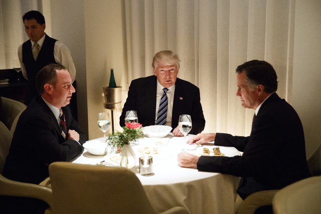 President-elect Donald Trump, center, eats dinner with Mitt Romney, right, and Trump Chief of Staff Reince Priebus at Jean-Georges restaurant, Tuesday, Nov. 29, 2016, in New York. (Evan Vucci/AP)