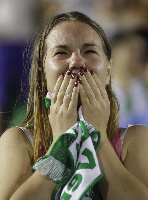 A fan of Brazil's soccer team Chapecoense mourns during a gathering inside Arena Conda stadium in Chapeco, Brazil, Tuesday, Nov. 29, 2016. (Andre Penner/AP))