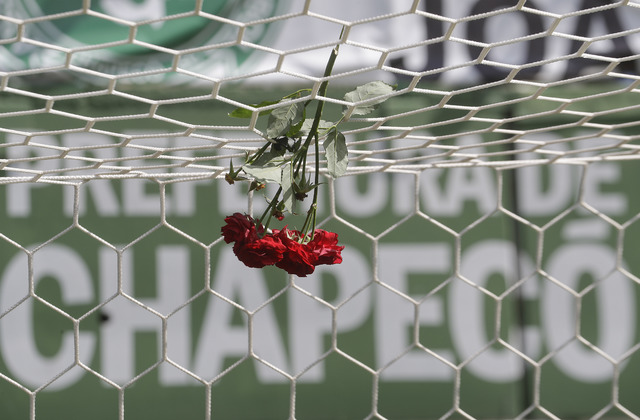 Flowers hang from a soccer net at the Arena Conda stadium in Chapeco, Brazil, Tuesday, Nov. 29, 2016. (Andre Penner/AP)