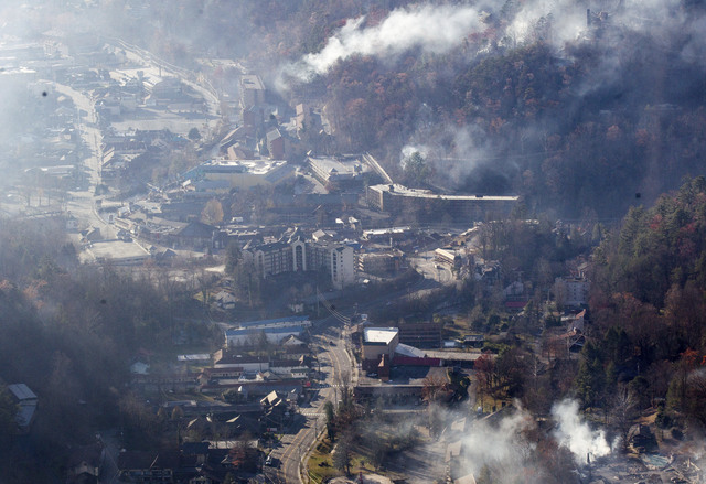 Burned structures are seen from aboard a National Guard helicopter near Gatlinburg, Tenn., Tuesday, Nov. 29, 2016. Thousands of people raced through a hell-like landscape to escape wildfires that  ...