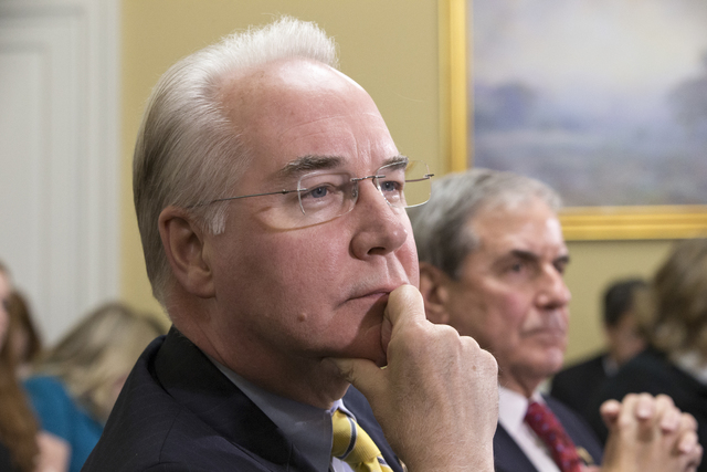 FILE - In this Jan. 5, 2016, file photo, Rep. Tom Price, R-Ga., chairman of the House Budget Committee appears before the Rules Committee, joined at right by Rep. John Yarmuth, D-Ky., on Capitol H ...