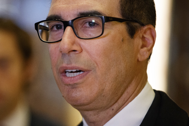 Steven Mnuchin, President-elect Donald Trump's nominee for Treasury Secretary, talks with reporters in the lobby of Trump Tower, Wednesday, Nov. 30, 2016, in New York. (Evan Vucci/AP)
