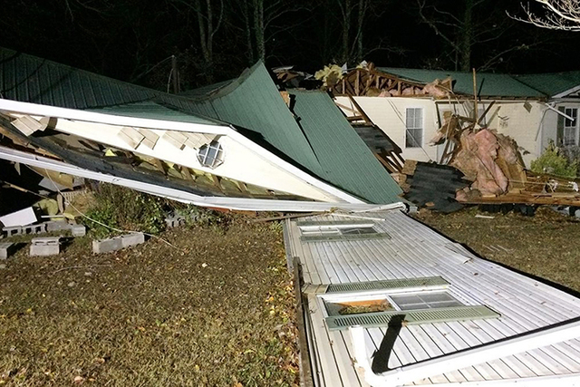 A suspected tornado downed buildings in Winston County, Alabama, and killed at least three people as a line of severe storms moved across the South overnight into early Wednesday morning, Nov. 30, ...