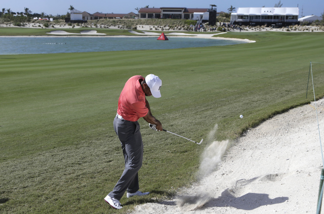 Tiger Woods hits from a bunker on the 18th hole during the Pro-Am at the Hero World Challenge golf tournament, Wednesday, Nov. 30, 2016, in Nassau, Bahamas. (Lynne Sladky/AP)