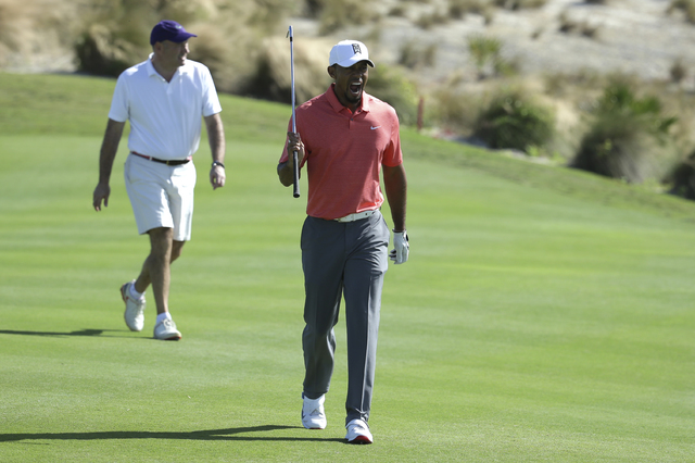 Tiger Woods yawns as he walks down the 17th fairway during the Pro-Am at the Hero World Challenge golf tournament, Wednesday, Nov. 30, 2016, in Nassau, Bahamas. (Lynne Sladky/AP)