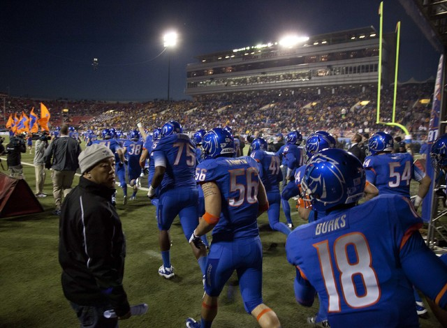Boise State players run onto the field before playing Arizona State in the Maaco Bowl NCAA college football game, Thursday, Dec. 22, 2011, in Las Vegas. (Julie Jacobson/AP)