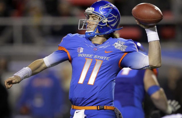 Boise State quarterback Kellen Moore (11) throws against Arizona State in the third quarter of the Maaco Bowl NCAA college football game, Thursday, Dec. 22, 2011, in Las Vegas. Boise State won 56- ...