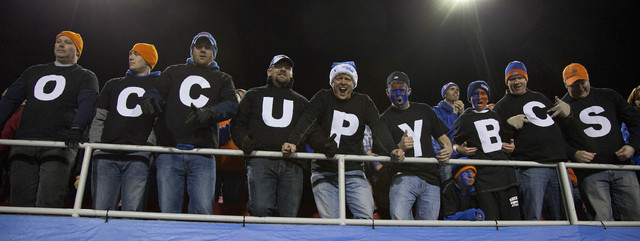 Boise State fans express their opposition to the BCS ranking system and the exclusion of their team from a championship game during the Maaco Bowl NCAA college football game against Arizona State, ...