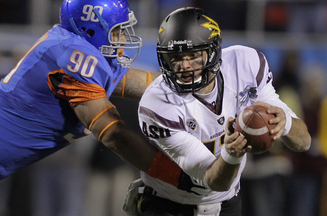 Arizona State quarterback Brock Osweiler (17) is sacked by Boise State defensive tackle Billy Winn (90) in the fourth quarter of the Maaco Bowl NCAA college football game, Thursday, Dec. 22, 2011, ...