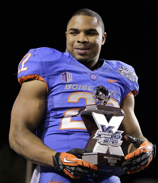 Boise State running back Doug Martin (22) holds the MVP trophy after being named the most valuable player of the Maaco Bowl NCAA college football game against Arizona State, Thursday, Dec. 22, 201 ...