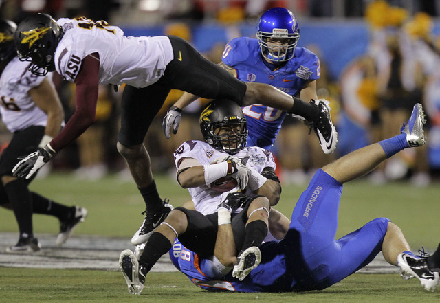 Arizona State safety Clint Floyd (9) is tackled by Boise State Broncos tight end Kyle Efaw (80) after intercepting a pass during the first half of the Maaco Bowl NCAA football game, Thursday, Dec. ...