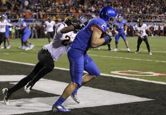 Boise State wide receiver Matt Miller (2) catches a pass for a touchdown against Arizona State cornerback Osahon Irabor (24) during the second quarter of the Maaco Bowl NCAA college football game, ...