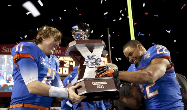 Boise State quarterback Kellen Moore (11) and running back Doug Martin (22) lift the game trophy after the Broncos defeated Arizona State 56-24 in the Maaco Bowl NCAA college football game, Thursd ...