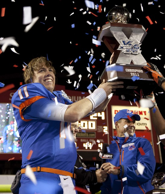 Boise State quarterback Kellen Moore (11) holds up the trophy after Boise State beat Arizona State 56-24 in the Maaco Bowl NCAA college football game, Thursday, Dec. 22, 2011, in Las Vegas. In the ...