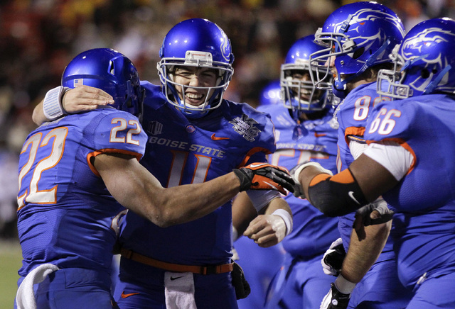 Boise State quarterback Kellen Moore (11) celebrates with running back Doug Martin (22) and other teammates after Martin rushed for a touchdown against Arizona State in the fourth quarter of the M ...