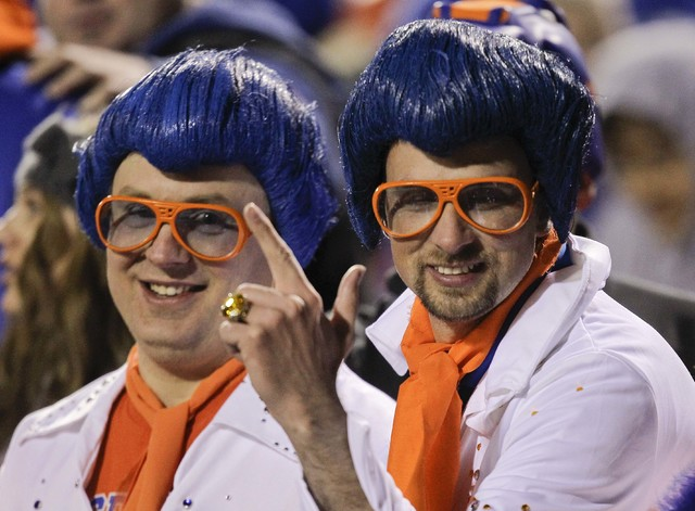 Boise State fans dressed as Elvis react in the grandstand during the Maaco Bowl NCAA college football game against Arizona State, Thursday, Dec. 22, 2011, in Las Vegas. Boise State won 56-24. (Jul ...