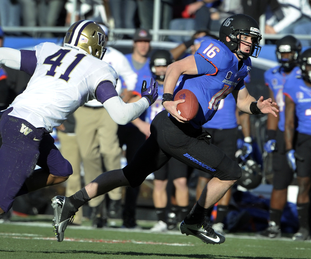 Boise State quarterback Joe Southwick (16) runs the ball with Washington's Travis Feeney (41) defending during second half of the MAACO Bowl NCAA college football game on Saturday, Dec. 22, 2012,  ...