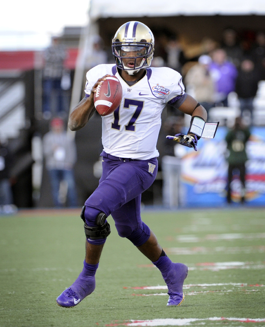 Washington quarterback Keith Price (17) looks for an open player the during second half of the MAACO Bowl NCAA college football game against Boise State, Saturday, Dec. 22, 2012, in Las Vegas. Boi ...
