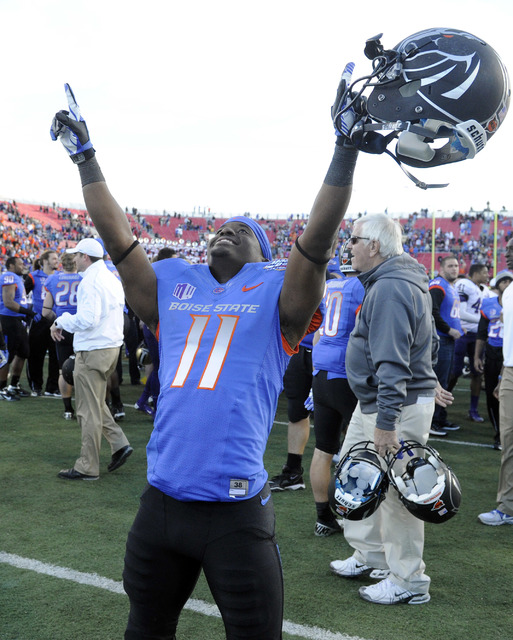 Boise State wide receiver Shane Williams-Rhodes (11) celebrates after his team won the MAACO Bowl NCAA college football game against Washington, Saturday, Dec. 22, 2012, in Las Vegas. Boise State  ...