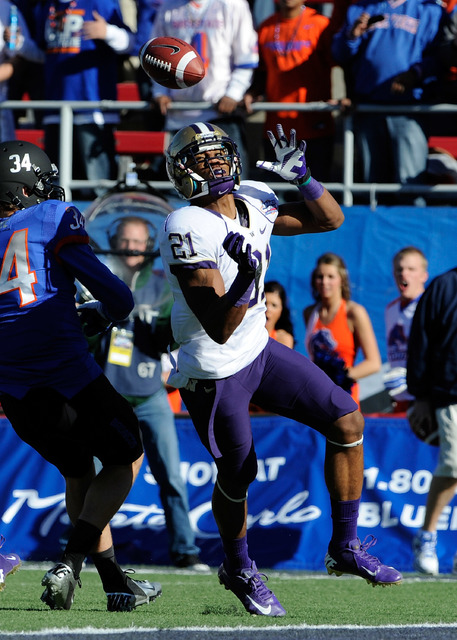 Washington cornerback Marcus Peters breaks up a reception against Boise State Kirby Moore (34) during first half of the MAACO Bowl NCAA college football game on Saturday, Dec. 22, 2012, in Las Veg ...