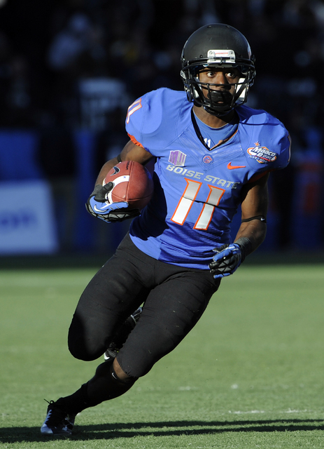 Boise State wide receiver Shane Williams-Rhodes (11) runs with the ball during the second half of the MAACO Bowl NCAA college football game against Washington, Saturday, Dec. 22, 2012, in Las Vega ...