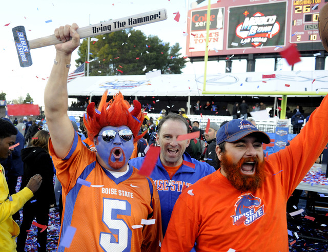 Boise State fans celebrate after their team's victory over Washington in the MAACO Bowl NCAA college football game on Saturday, Dec. 22, 2012, in Las Vegas. Boise State won 28-26. (David Becker/AP)