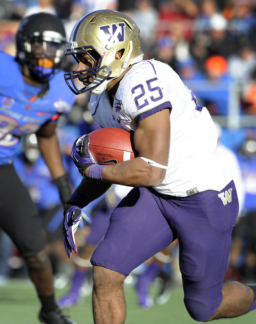 Washington tailback Bishop Sankey (25) runs with the ball during second half of the MAACO Bowl NCAA college football game against Boise State, Saturday, Dec. 22, 2012, in Las Vegas. Sankey was awa ...