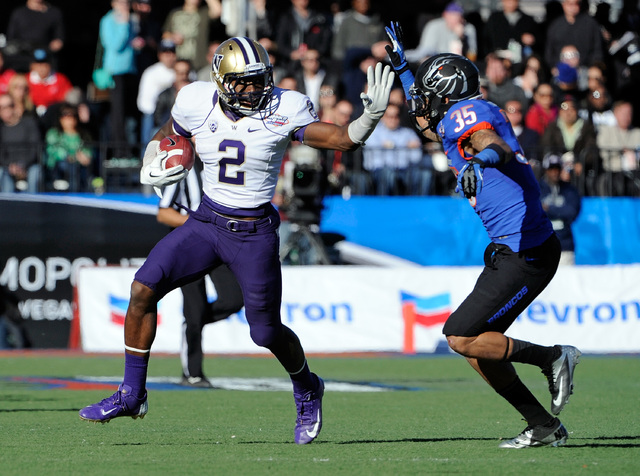 Washington's  Kasen Williams (2) brings the ball down field with Boise State Darian Thompson (35) adding pressure during first half of the MAACO Bowl NCAA college football game on Saturday, Dec. 2 ...