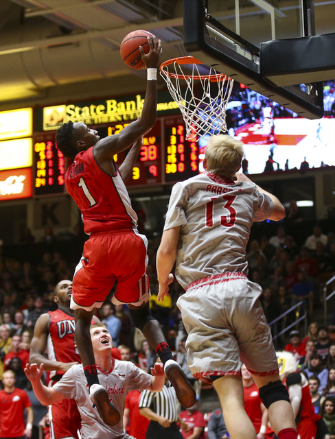 UNLV guard Kris Clyburn (1) goes up to score over Southern Utah guard Race Parsons (13) during a basketball game at the Centrum Arena in Cedar City, Utah on Wednesday, Nov. 30, 2016. Chase Stevens ...