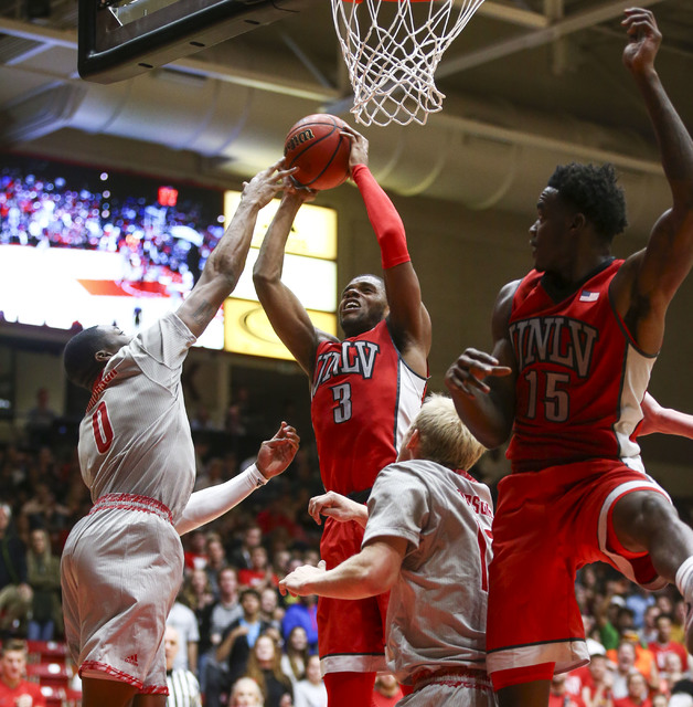 UNLV forward Tyrell Green (3) gets a rebound over Southern Utah guard Randy Onwuasor (0) during a basketball game at the Centrum Arena in Cedar City, Utah on Wednesday, Nov. 30, 2016. UNLV won 89- ...