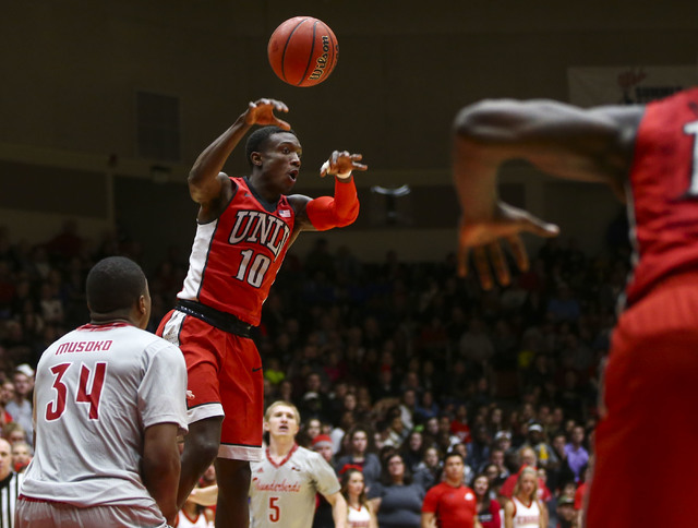UNLV guard Zion Morgan (10) passes the ball over Southern Utah forward Christian Musoko (34) during a basketball game at the Centrum Arena in Cedar City, Utah on Wednesday, Nov. 30, 2016. UNLV won ...