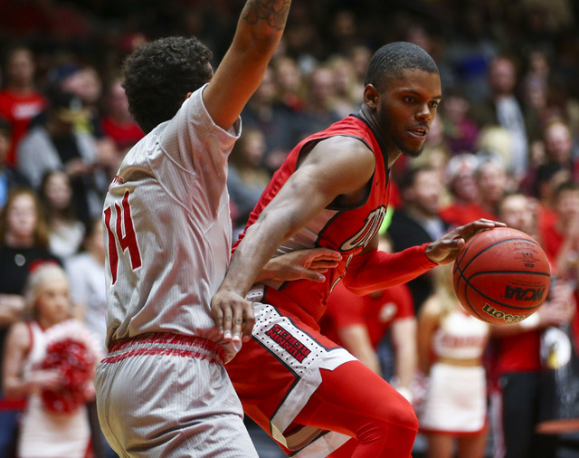 UNLV forward Tyrell Green (3) looks to get past Southern Utah guard James McGee (14) during a basketball game at the Centrum Arena in Cedar City, Utah on Wednesday, Nov. 30, 2016. UNLV won 89-81.  ...