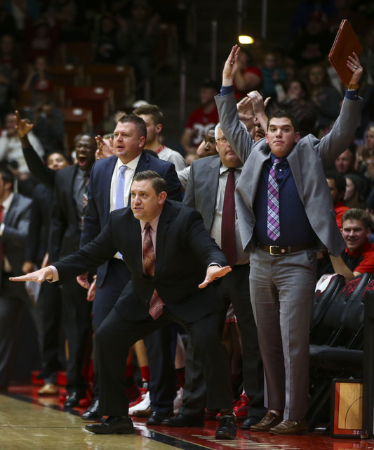 Southern Utah head coach Todd Simon, lower left, motions to his team as they play against the UNLV during a basketball game at the Centrum Arena in Cedar City, Utah on Wednesday, Nov. 30, 2016. UN ...