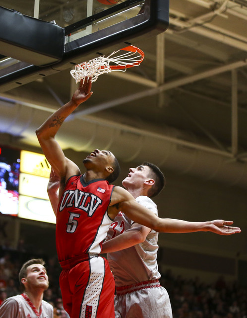 UNLV guard Jalen Poyser (5) gets a shot in over Southern Utah forward Ivan Madunic (22) during a basketball game at the Centrum Arena in Cedar City, Utah on Wednesday, Nov. 30, 2016. UNLV won 89-8 ...