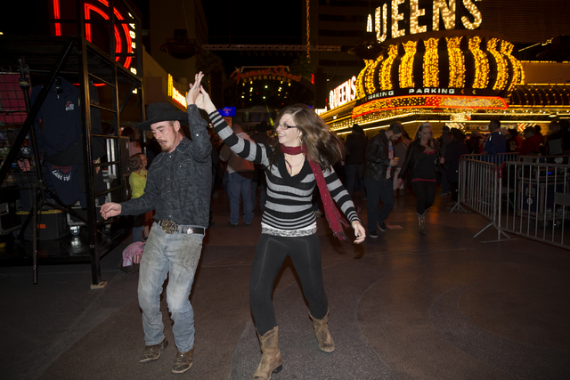Shane Ramseier, left, and his wife Audra Mueller dance to the music during the 30th Annual Downtown Hoedown at the Fremont Street Experience on Wednesday, Nov. 30, 2016, in Las Vegas. Erik Verduzc ...