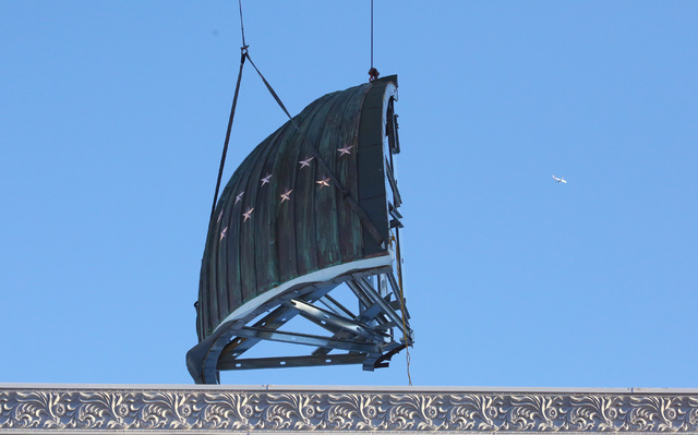 Construction crews use a crane to place a dome in four sections on top of the new Nevada Supreme Court building at Clark Avenue and Fourth Street in downtown Las Vegas, Wednesday, Nov. 30, 2016. ( ...