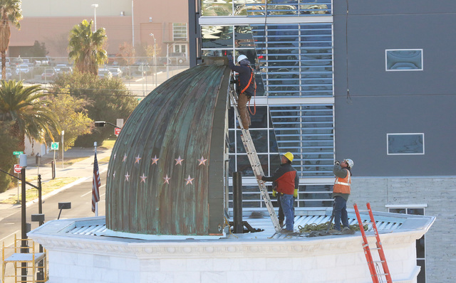 Construction crews place a dome in four sections on top of the new Nevada Supreme Court building at Clark Avenue and Fourth Street in downtown Las Vegas Wednesday, Nov. 30, 2016. (Bizuayehu Tesfay ...