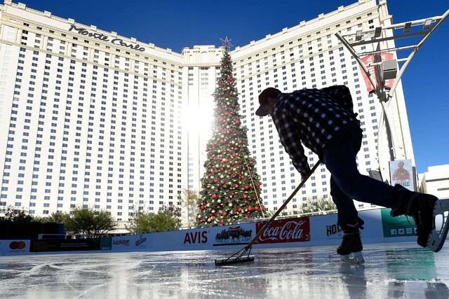 Dallis Holmes makes final adjustments to the temporary ice rink set up in front of the T-Mobile Arena in Las Vegas. (David Becker/Las Vegas Review-Journal Follow @davidjaybecker)
