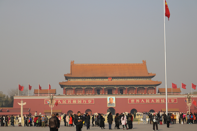 Domestic and international tourists walk toward an entrance gate to the Forbidden City in Beijing, China Wednesday, Nov. 30, 2016.  China's rising middle class has led to an increase in Chinese co ...