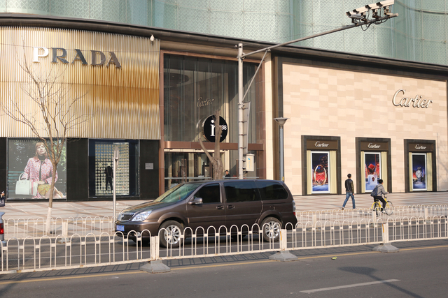 Prada and Cartier in Beijing, China welcome shoppers Wednesday, Nov. 30, 2016.  China's middle class increased six fold between 2010 and 2015. A 2016 report from wealth research firm Hurun Report  ...