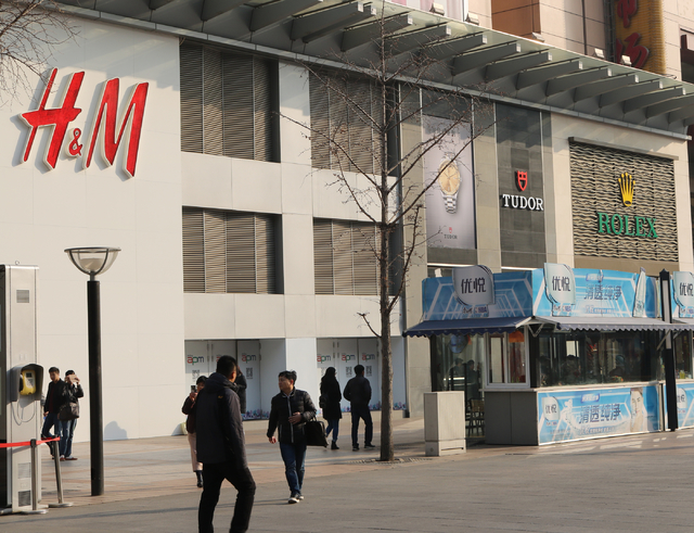 H&M and Rolex in Beijing, China welcome shoppers Wednesday, Nov. 30, 2016.  China's middle class increased six fold between 2010 and 2015. A 2016 report from wealth research firm Hurun Report  ...