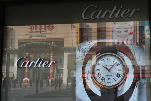 A Cartier store in Beijing, China welcome shoppers Wednesday, Nov. 30, 2016.  China's middle class increased six fold between 2010 and 2015. A 2016 report from wealth research firm Hurun Report fo ...