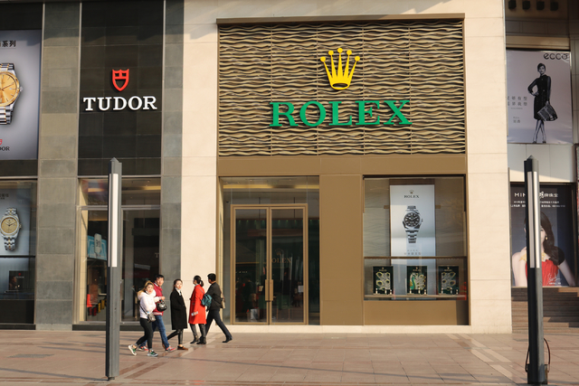 A Rolex store in Beijing, China welcome shoppers Wednesday, Nov. 30, 2016.  China's middle class increased six fold between 2010 and 2015. A 2016 report from wealth research firm Hurun Report foun ...