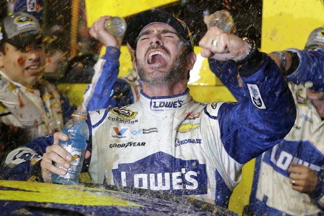 Jimmie Johnson celebrates his NASCAR Sprint Cup auto race and season title win Sunday, Nov. 20, 2016, in Homestead, Fla. (Terry Renna/AP)
