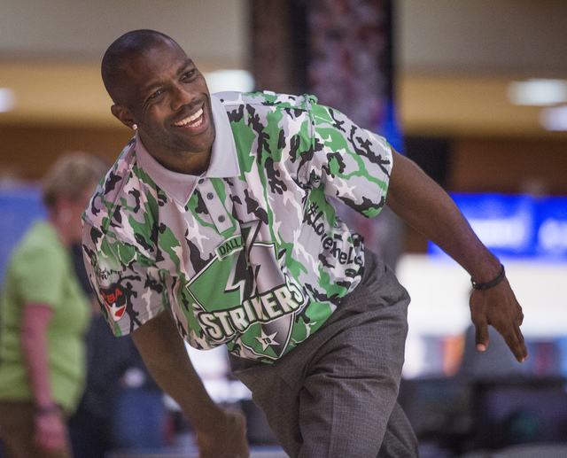 Former NFL superstar Terrell Owens bowls during an event for the Bowlers Journal at the South Point bowling center Wednesday, Oct. 30,2013. This is the 100th anniversary of the popular bowling mag ...