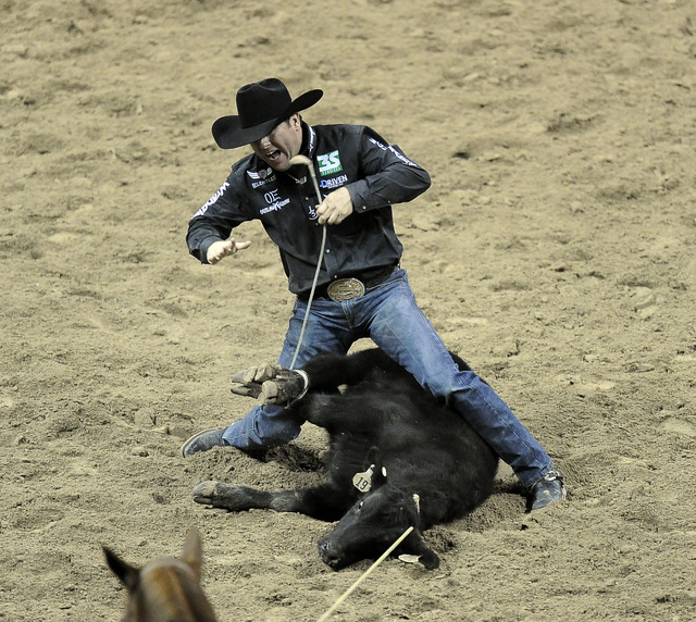 PRCA tie down roper Trevor Brazile earns a second place time of 7.90 seconds during the second go-round of the National Finals Rodeo at the Thomas & Mack Center in Las Vegas Friday, Dec. 5, 20 ...